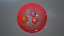 Representación de la nueva partícula observada por LHCb, que contiene dos quarks pesados. (Imagen: Daniel Dominguez / CERN)