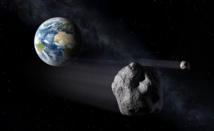 Impresión artística de asteroides que pasando cerca de la Tierra. Fuente: ESA.