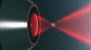 Ilustración de una nanopartícula atrapada por un láser. Imagen: Iñaki Gonzalez y Jan Gieseler.