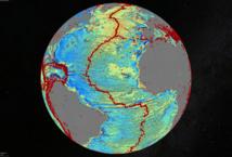 Un modelo de gravedad marino del Atlántico Norte. Los puntos rojos muestran la ubicación de los terremotos con magnitud superior a 5,5 y resaltan la ubicación actual de la expansión de crestas y fallas transformantes del fondo oceánico. Imagen: David Sandwell. Fuente: Instituto Scripps de Oceanografía, Universidad de California en San Diego (EEUU).