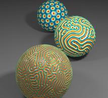 Dependiendo de la curvatura de la superficie de un objeto, sus arrugas superficiales pueden seguir desde un patrón de hexágonos (bola al fondo) hasta uno de laberintos (delante); o un patrón intermedio (bola situada en medio). Imagen: Norbert Stoop. Fuente: MIT.