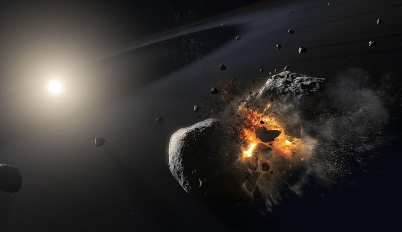 Recreación artística de la colisión ocurrida entre dos colosos cósmicos que orbitan a la brillante estrella Fomalhaut (al fondo), que originó una nube de polvo confundida por los astrónomos con un planeta que en realidad nunca existió. Crédito:ESA / NASA, M. Kornmesser