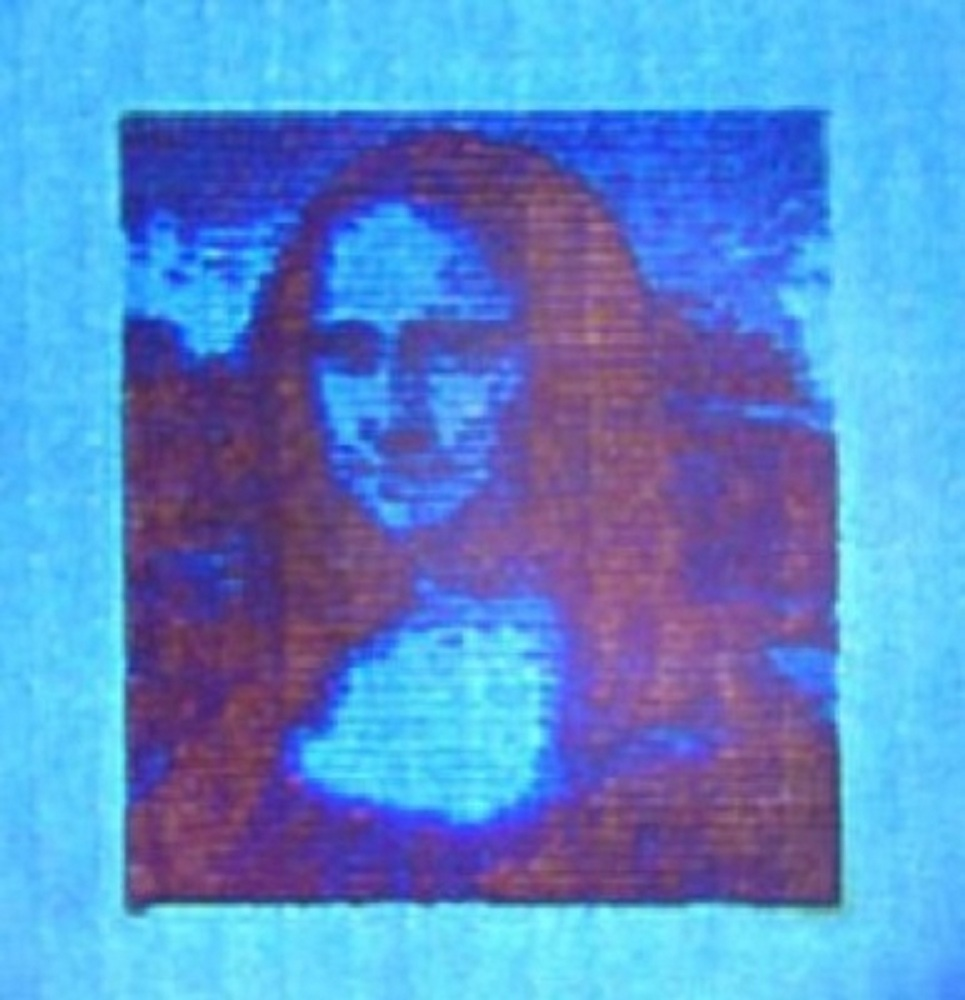 Mona Lisa microscópica, de sólo 50 micras de largo, y 10.000 veces más pequeña que la original. Fuente: DTU.